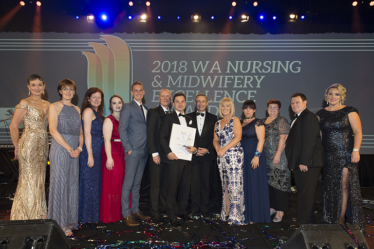 Winners of the 2018 Western Australian Nursing and Midwifery Awards onstage at the gala dinner.