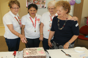 RGH Radio Lollipop volunteers Meryl Reilly, Jeni Webster, Jan McGlinchey and Teresa Ukich cutting a birthday cake