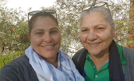 A close up photograph of two female Aboriginal Health Liaison Officer